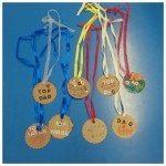 we made some medals for our super dad's for fathers day