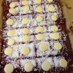 We made coconut lamington cake and decorated it with chocolate buttons